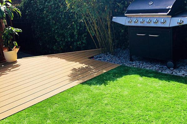 Artificial-grass-in-back-garden-next-to-bbq