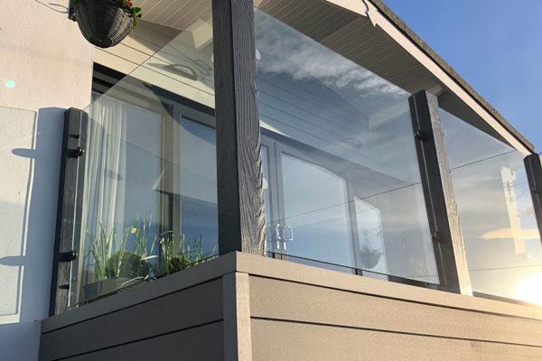 Glass-balustrade-on-decking-in-devon